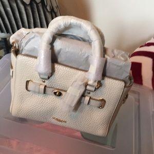 Coach handbag, cream colored,